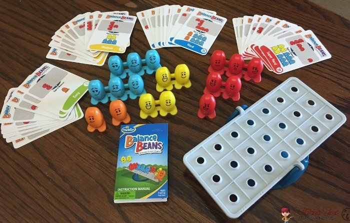Balance Beans is a game for ages 5+ that teaches kids logic and problem solving, as well as basic physics, all while they have fun balancing beans on a seesaw. @ThinkFun #balancebeans #game